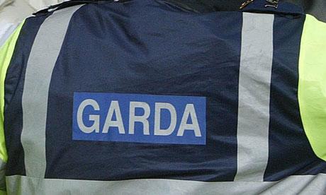A Garda badge on an officer's jacket