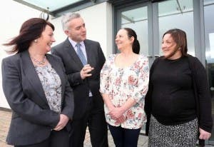 Junior Ministers Jennifer McCann and Johnathan Bell chatting to Helena Kelly and Sharon Casey, participants on the  Community Family Support Delivering Social Change Signature Programme,  during a visit to the Shared Future Centre, Derry. Photo Lorcan Doherty Photography