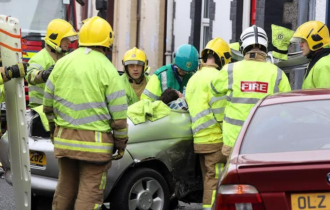 Firefighters cutting the woman free from the Ford Puma.