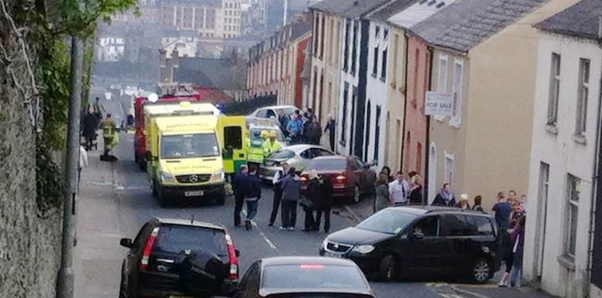 Emergency services at the scene of the accident on Creggan Hill.