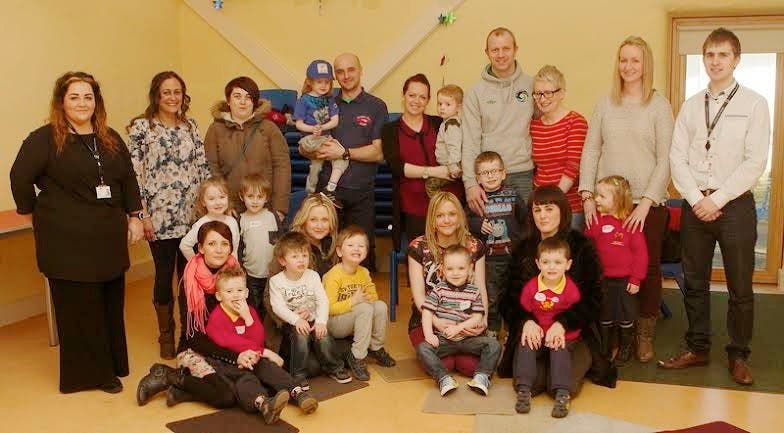 """Group of parents with their children at the """"Handa's Surprise"""" events. Included are Jennifer Griffiths, co-ordinator, Greater Shantallow Area Partnership, with (on left), Michaela Devine, Derry City Council Community Relations Department, and (on right), Dean Steele, Derry City Council Community Relations Department. (Photo: Tom Heaney, nwpresspics)"""