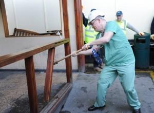 Respiratory consultant Martin Kelly demolishes the smoking shelter at Altnagelvin Hospital.