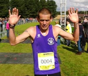 Foyle Valley AC's Keith Shiels celebrates winning last year's Waterside Half Marathon.