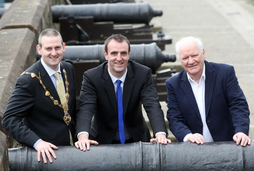 Evironment Minister Mark H Durkan (centre) announcing the £35,000 funding for Derry's Walls. Included are the Mayor of Derry Cllr Martin Reilly and Eamonn Deane, director, Hoywell Trust.