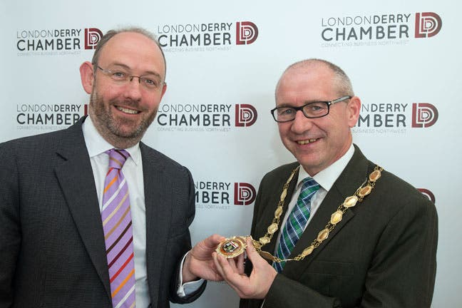 New president of Derry Chamber of Commerce, Gerry Kindlon (right), receiving the chain of office from his predecessor, Gerry Gilliland. Photo: Martin McKeown. Inpresspics.com.