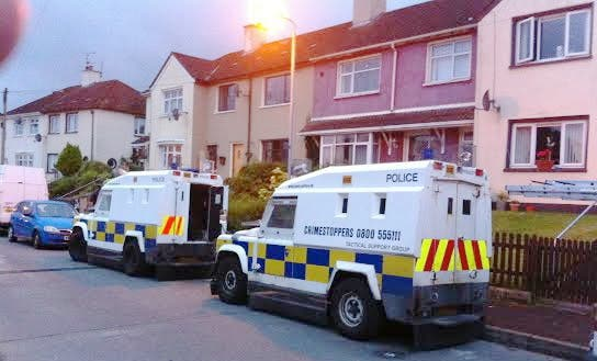 Police landrovers outside the Bradley home in Creggan.