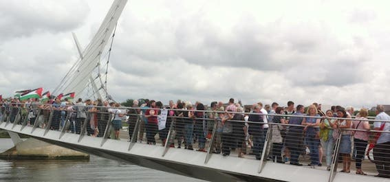 "The ""human chair"" across Derry's Peace Bridge in support of the people of Gaza."