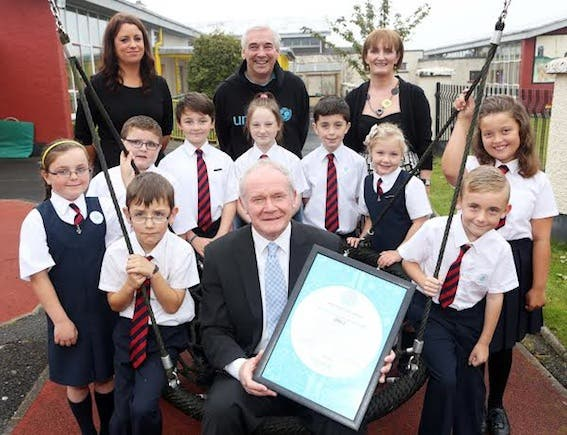Deputy First Minister Martin McGuinness pictured with Mrs. Aine O'Connor, teacher, Paul Clarke, UNICEF Ambassador, Miss Orla McDonnell, Principal, and pupils from Holy Child Primary School, Derry, who today received the UNICEF Level 2 Rights Respecting School Award. Photo: Lorcan Doherty Photography