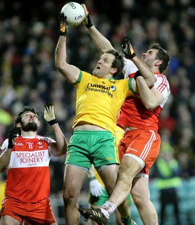 Michael Murphy wins this aerial duel as Donegal defeated Derry in the National League on Saturday night in Mac Cumhaill Park, Ballybofey. Pic Gary Foy
