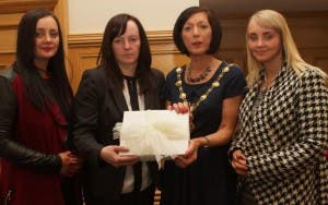 Mayor Brenda Stevenson handing over Books of Condolence to Sharon McCrossan. On left, is Christina McCrossan, and on right, Charlene McCrossan, daughters. (Photo - Tom Heaney, nwpresspics).