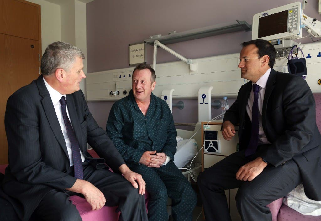 Health Minister Jim Wells, along with the Irish Health Minister, Leo Varadkar,chatting to patient Christopher Dickie, from Articlave, during a visit to the new Cath Labs  to view the new cardiology service and then visited the site of the hospital's new Radiotherapy Unit.