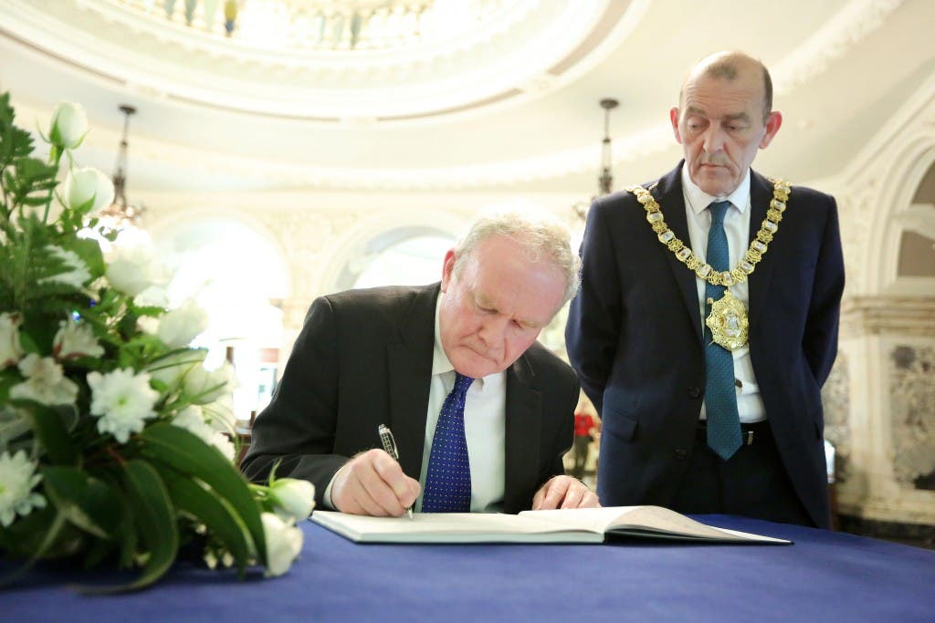 The deputy First Minister Martin McGuinness today visited Belfast City Hall to sign the book of condolence which opened today for the 38 people who died in the attack at a Tunisian beach resort last Friday. Pictured with the deputy First Minister is Lord Mayor Arder Carson. Picture by Kelvin Boyes / Press Eye.