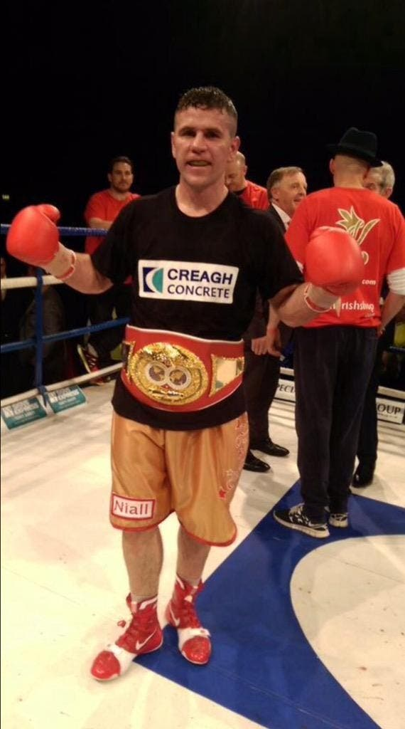 Eamonn O'Kane his IBF title In Co Derry last May but has now announced his retirement from boxing