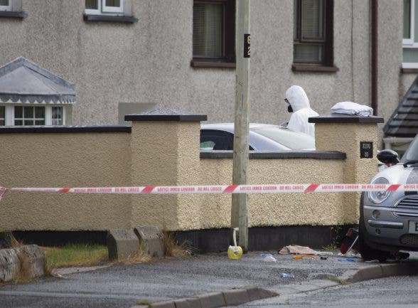Forensic officers entering the scene of the fatal stabbing in Derry. (North West Newspix)