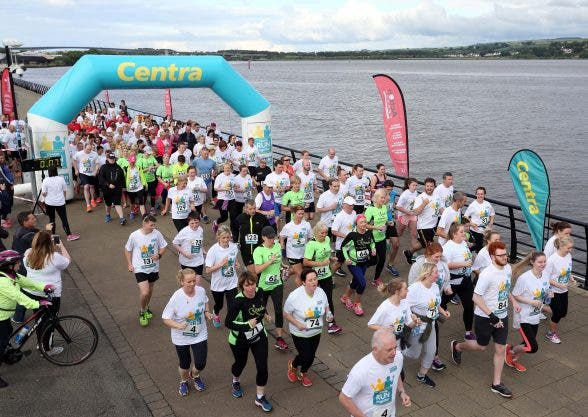 Over 250 families, friends and colleagues paired up for the 5k event which made its way across the Peace Bridge and into St ColumbÕs Park, raising vital funds for local charity Action Cancer.