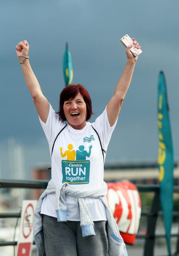 ©/Lorcan Doherty Photography - 22nd June 2016. Delight for Heather Francey, Belfast, at the finish line of the Centra Run Together race in DerryOver 250 families, friends and colleagues paired up for the 5k event which made its way across the Peace Bridge and into St ColumbÕs Park, raising vital funds for local charity Action Cancer. Run Together is a set of four 5k races taking place across Derry, Belfast and Mid Ulster between June and October which encourages people to run with a partner, son, daughter, friend or neighbour. Photo Lorcan Doherty Photography