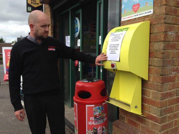 Waterside shop owner Richard Campbell with damaged defibrillator