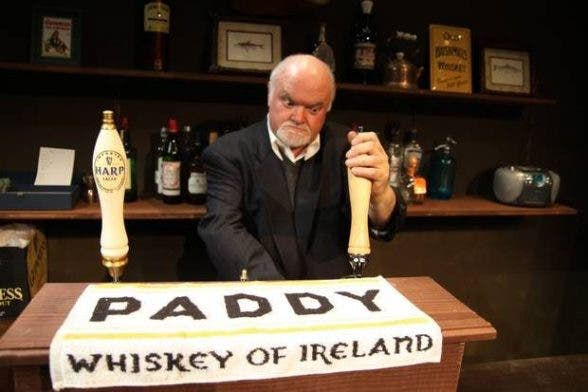 Gordon Fulton, playing the part of Sammy the barman, who passed away in Derry aged 67