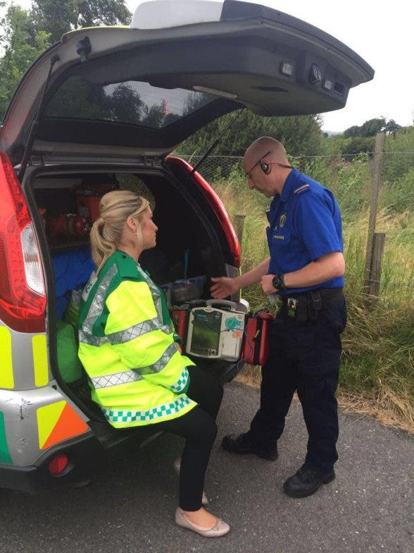 Health Minister Michelle O'Neill talking to a first responder paramedic