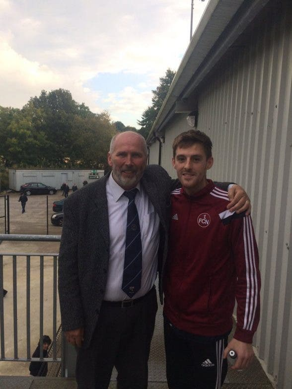 Institute FC chairman Bill Anderson welcomes back player Niall Grace to the club on Saturday