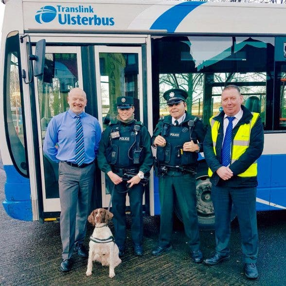 Rosie the police drugs sniffer dog with neighbourhood PSNI officers and Translink staff in Derry trying to keep school safe and out of the clutches of drug dealers